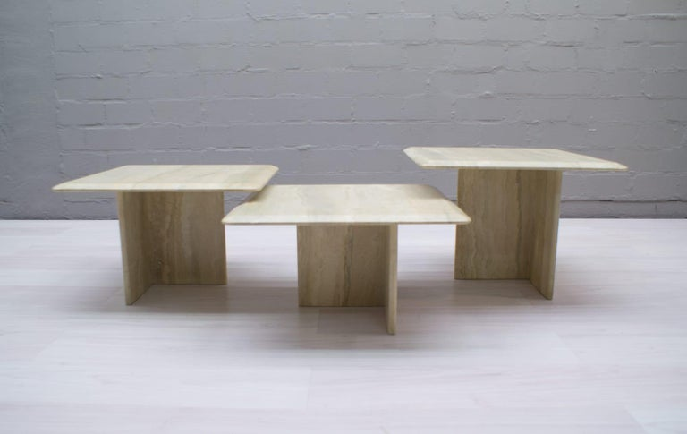 Set of square travertine coffee tables in very good condition.  These coffee tables are made from solid travertine.  They have different heights so they can be combined in many different ways.  Measures: Height 32cm / 12.59