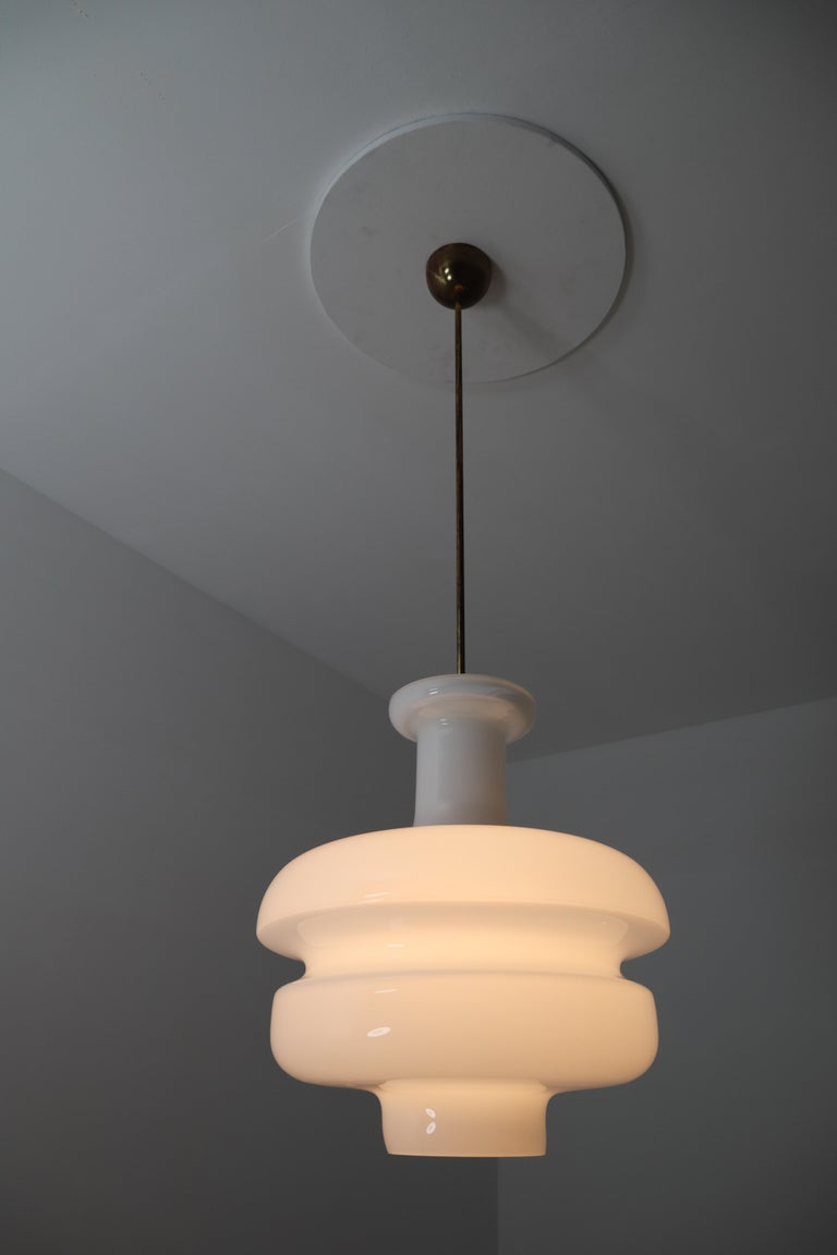 Mid-20th Century Set of Three Large Midcentury Pendants, Opaline Glass and Brass, Europe, 1960s For Sale
