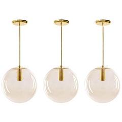 Set of Three Limburg Globe Pendant Lights, Brass and Smoked Glass, 1970s