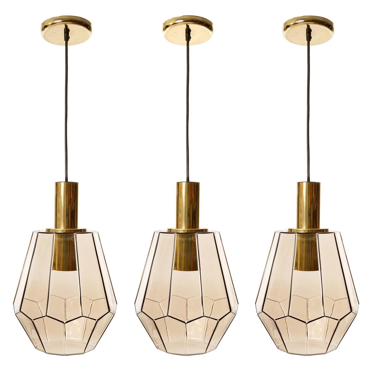 Set of Three Limburg Pendant Lights, Brass and Amber Smoked Glass, 1970s