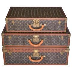 Set of Three Louis Vuitton Suitcases Alzer 80 Alzer 80 Alzer 70 1970