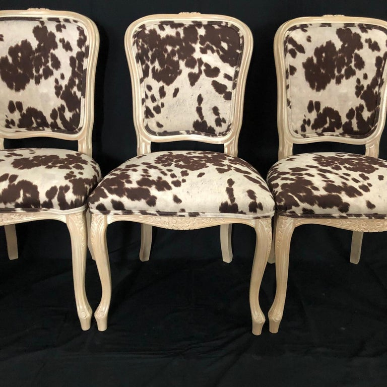 Stylish spin on classic set of 3 petite Louis XV style bleached carved wood chairs having chic high end faux hide upholstery with double piping detail. Measure: Seat height 19.  #5115.