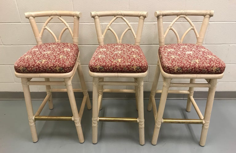 Set of three McGuire bamboo bar or counter stools with a brass footrest