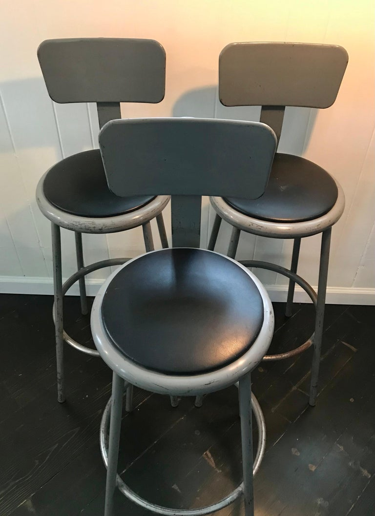 American Set of Three Mid Century Industrial Metal Bar Stools with Backrests For Sale
