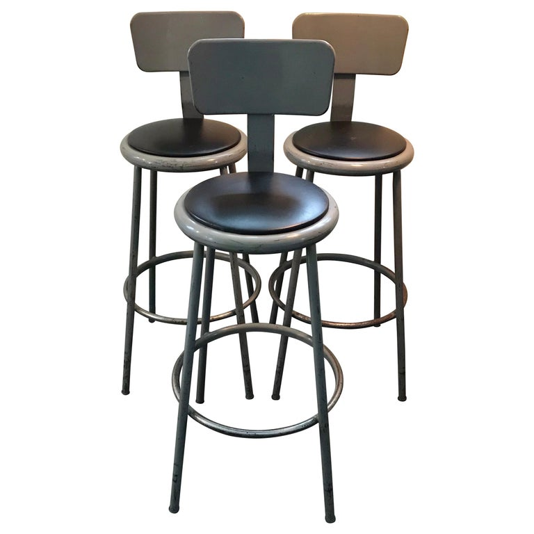 Set of Three Mid Century Industrial Metal Bar Stools with Backrests For Sale