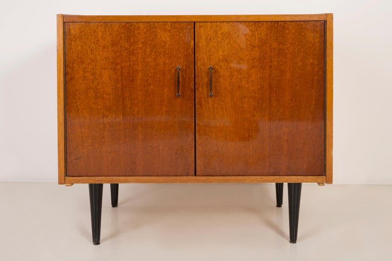 TV side table/sideboard from the 1960s. It was manufactured in Poland. The table was made of wood, it was refreshed. Very good original vintage condition.