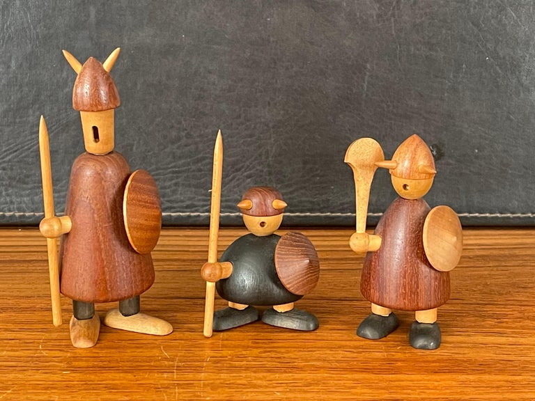 Set of three midcentury Danish Viking figures made of mixed woods by Jacob Jensen, circa 1950s. The figures are in good vintage condition and measure: 5.5
