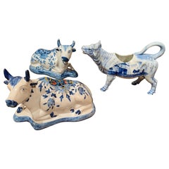 Set of Three Midcentury Dutch Blue and White Hand Painted Porcelain Cow Figures