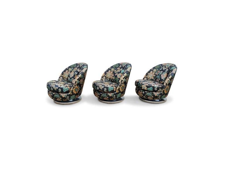 Set of three Milo Baughman tilt & swivel lounge chairs chrome bases.