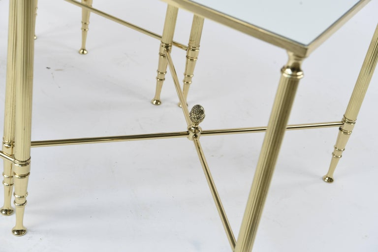 High style with this set of polished brass and mirrored nesting tables! A very sleek and Classic design, these tables will highlight any living room!