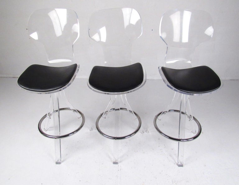 Set of Three Modern Lucite Swivel Bar Stools In Good Condition For Sale In Brooklyn, NY