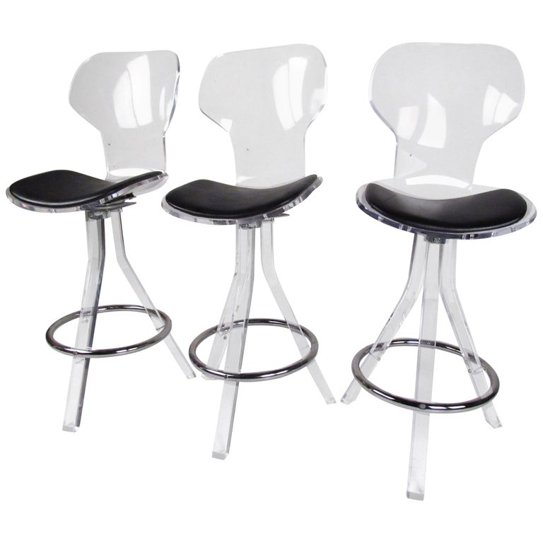 Set of Three Modern Lucite Swivel Bar Stools For Sale
