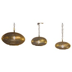 Set of Three Oval Shaped Brass Pendant Chandeliers in Graduating Sizes