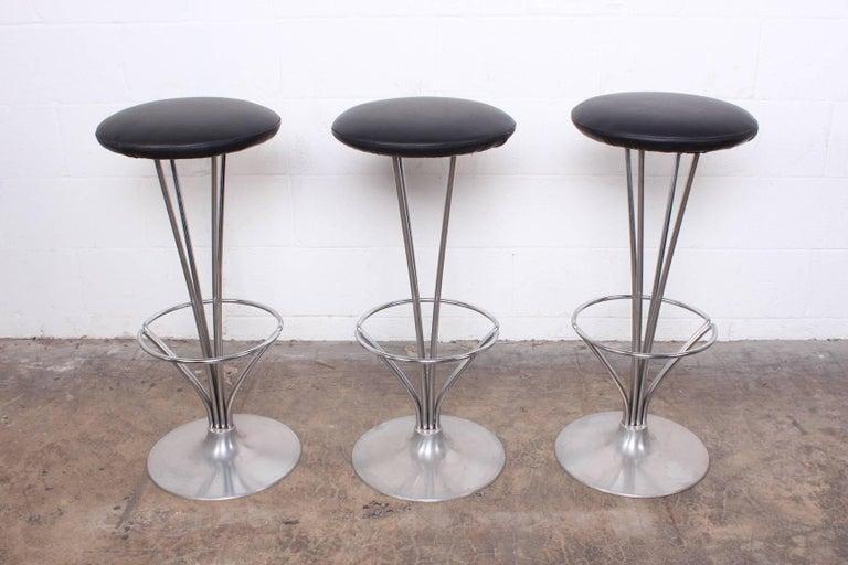 A set of three barstools by Piet Hein for Fritz Hansen.