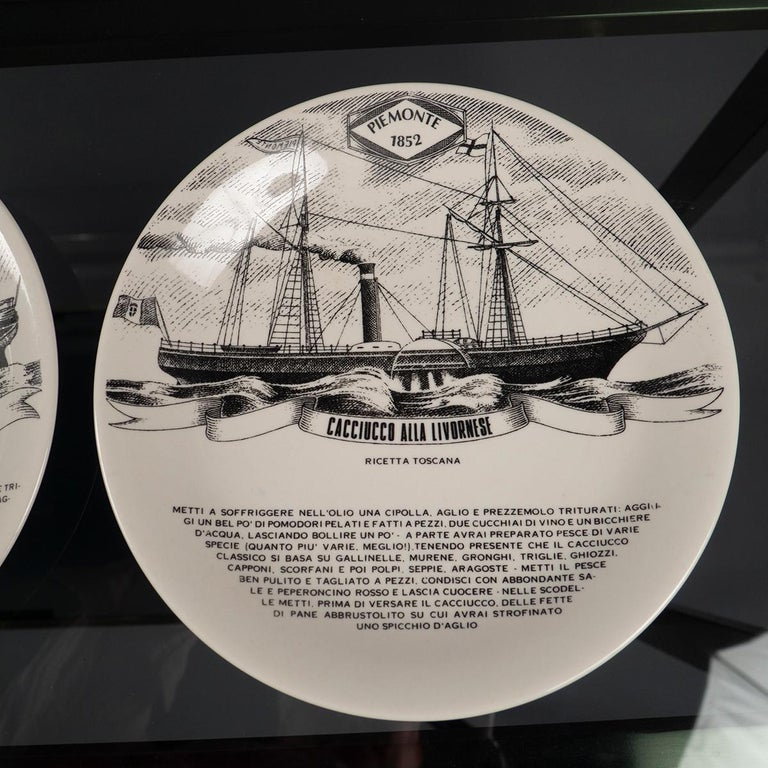 Silk-screened porcelain plates depicting various steam brigs with recipes, such as Cacciucco alla Livornese, Sfincione di San Vito, and pasta con le sarde.
