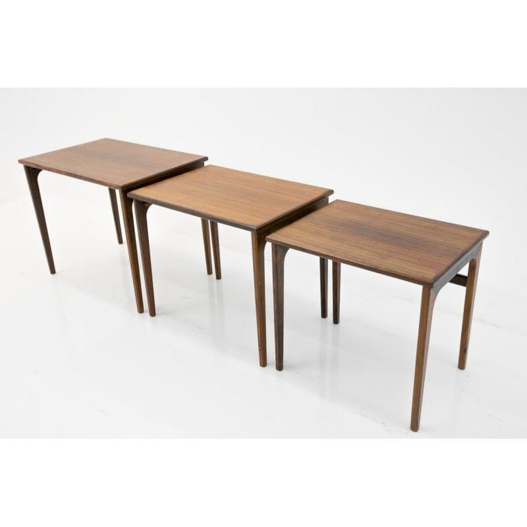 Set of three Classic Danish design rosewood nesting tables. Preserved in very good condition. Can be used in many ways. Measures: Height 47/45/43 cm Width 7.5/52/45.5 cm Depth 39.5/37/34.5 cm.