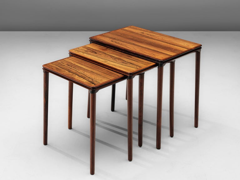 Scandinavian Modern Set of Three Rosewood Nesting Tables with Elegant Details For Sale