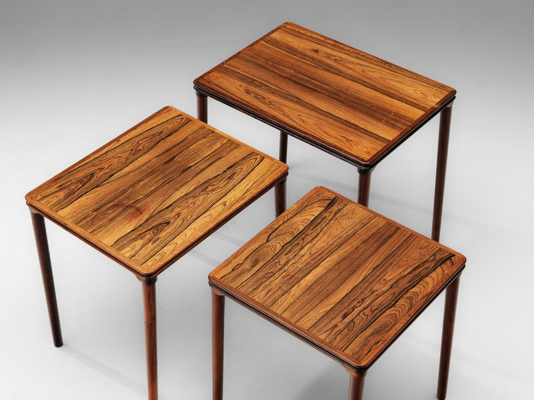 Scandinavian Set of Three Rosewood Nesting Tables with Elegant Details For Sale