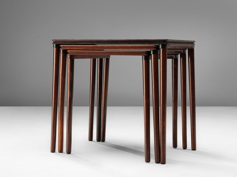 Mid-20th Century Set of Three Rosewood Nesting Tables with Elegant Details For Sale