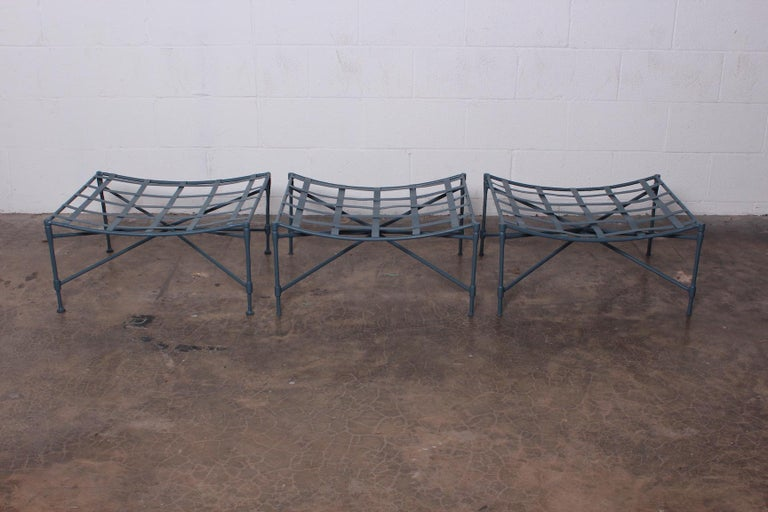 A set of three sculptural iron lattice top ottomans / benches by Salterini. Newly powder coated.