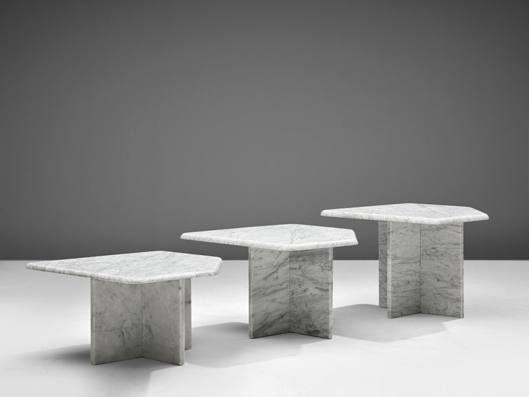 Set of three coffee tables, marble, Italy, 1970s  This set of three geometrical marble coffee tables each feature a polygonal tabletop and a x-shaped base. The aesthetics are archetypical for postmodern design, bearing references to architectural