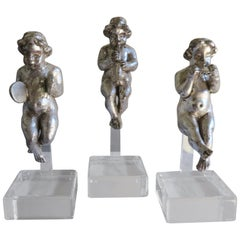 Set of Three Silver Gilt Musical Cherubs on Lucite Bases