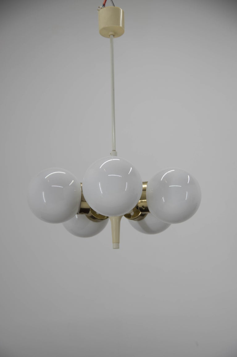 Three brass and opaline glass chandeliers by Elektroinstala Decin, made in 1960s. 5x60W, E25-E27 sockets.