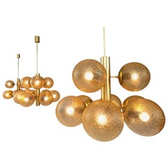 Set of Three Sputnik Chandeliers in Tinted Glass and Brass, 1960s