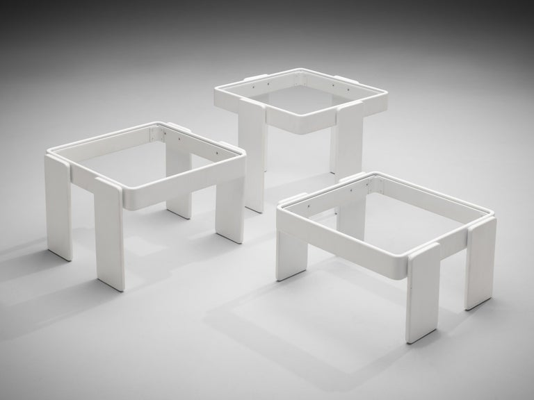 Three side tables, wood, glass, Italy, 1970s  In strong resemblance to Gianfranco Frattini's design of the model '780' this set of three stackable nesting tables features a squared top in glass. Four flat legs lift the table up to three different