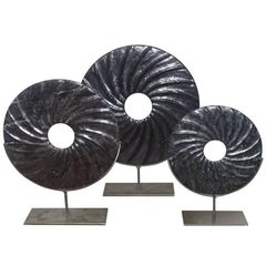 Set of Three Swirl Pattern Stone Rings on Stands, China, Contemporary
