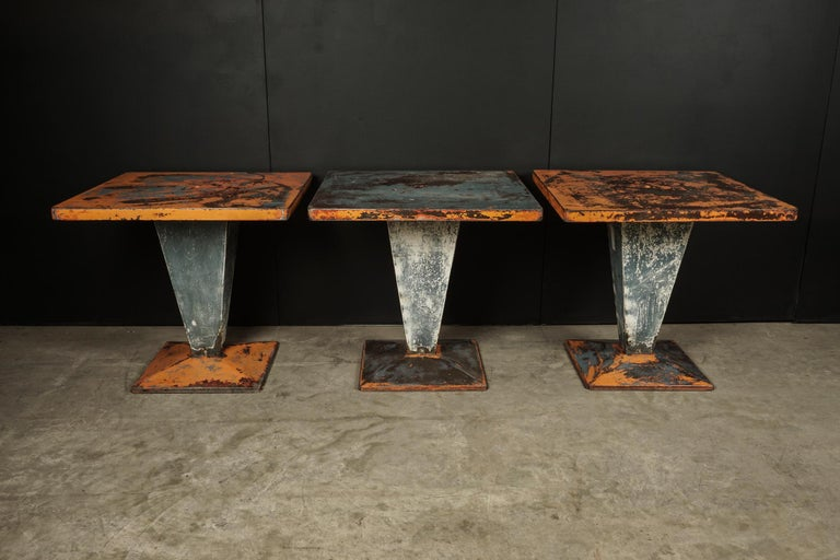 Set of three Tolix Bistro tables with original paint from France, circa 1950. Solid construction with superb original color and wear.