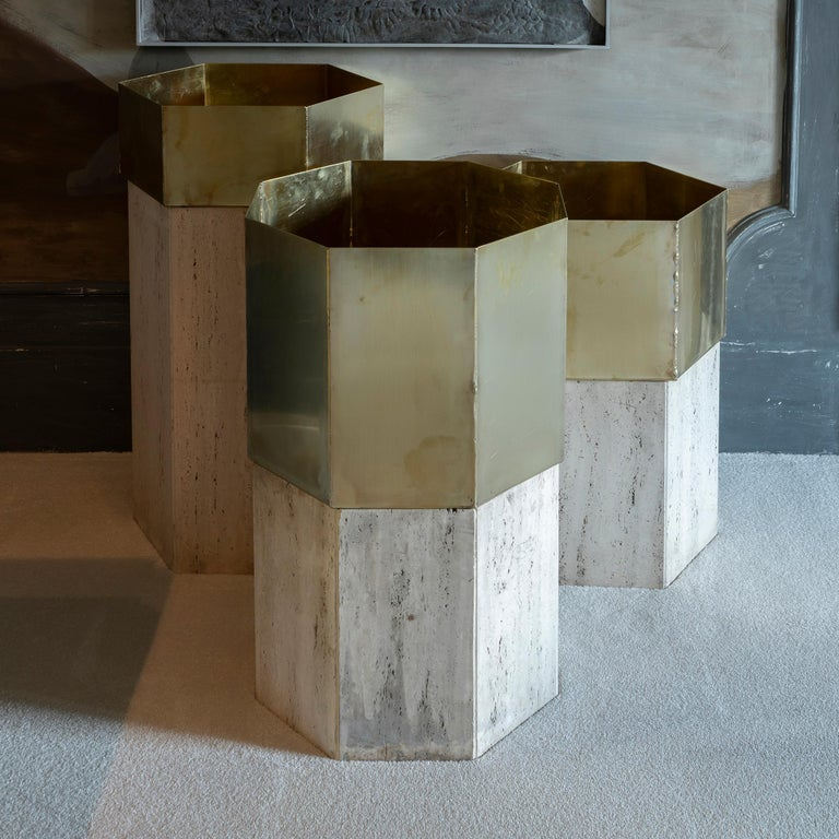 Set of three travertine and natural brass planter, perfect condition and vintage patina, measurements are: tall one cm 52 x 45 x H 90, medium one cm 51 x 53 x H 80, short one cm 52 x 45 x H 70, Italy, circa 1970s.