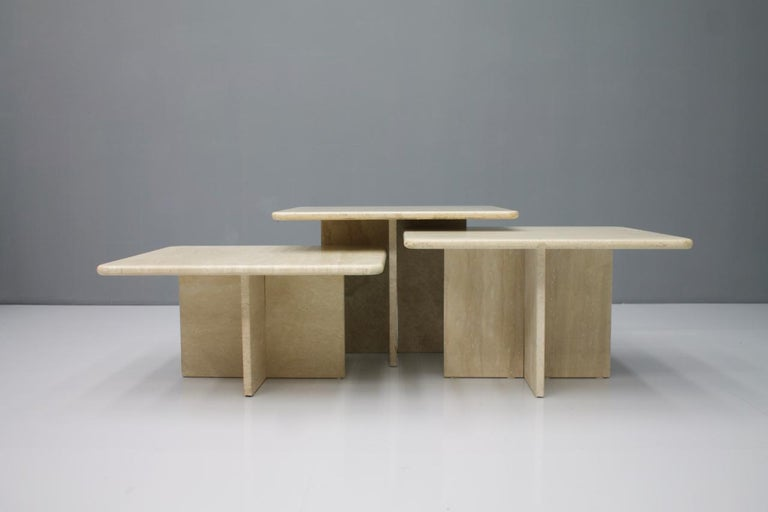 Set of three travertine side or coffee Tables, Italy, 1970s    Measures:  1 x W 23.6 x D 23.6 in. x H 15.7 in.  1 x W 23.6 x D 23.6 in. x H 14 in.  1 x W 23.6 x D 23.6 in. x H 12 in.    1 x 60 x 60 x 40 cm  1 x 60 x 60 x 35.5 cm  1 x 60 x