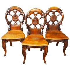 Set of Three Victorian Mahogany Heraldic Hall Chairs, circa 1840