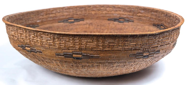 Set of three vintage Asian baskets, 20th century. Each basket has a different, intricately woven design. Three sizes: 25-3/4 inch diameter x 7-1/4 inch high, 20-7/8 inch diameter x 5 inch high, 15-1/2 inch diameter x 3-1/4 high.