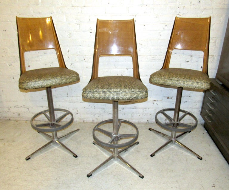 Vintage modern set of three stools featuring a vinyl seat and Lucite backrest on a sturdy metal frame.  (Please confirm item location NY or NJ with dealer).