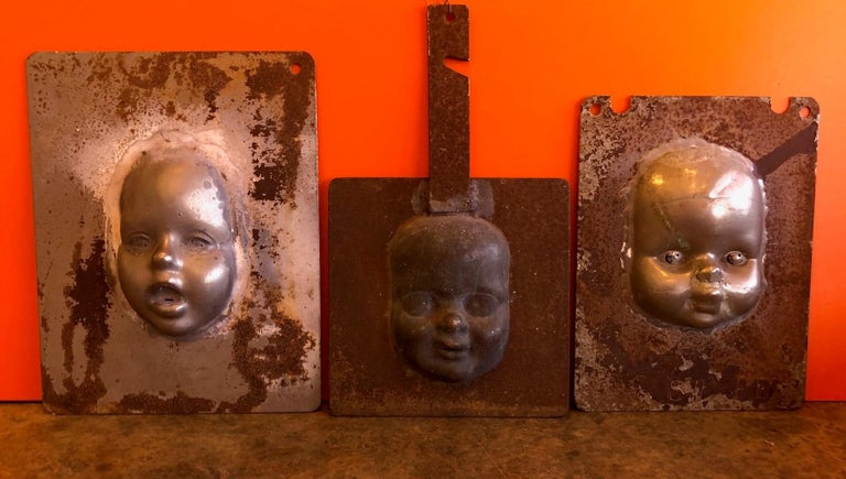 Rare set of three vintage metal doll head / face molds, circa 1930s. The Industrial looking pieces are quite unique and make a great