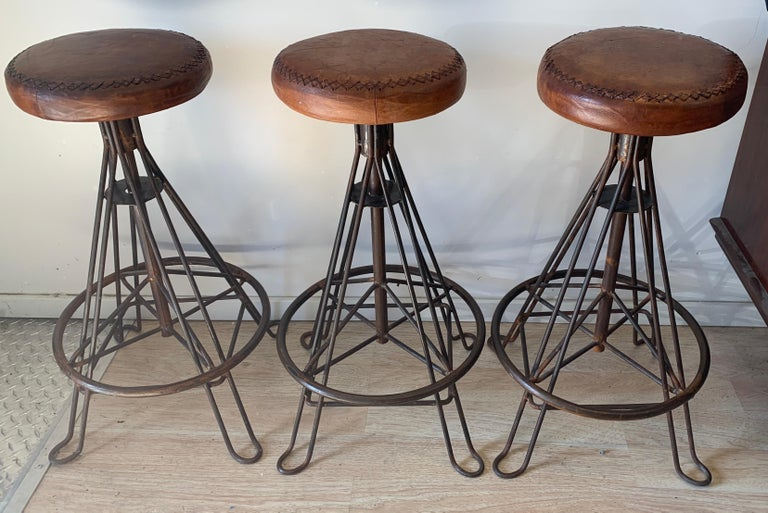 20th Century Set of Three Wrought Iron and Stitched Leather Bar Stools For Sale