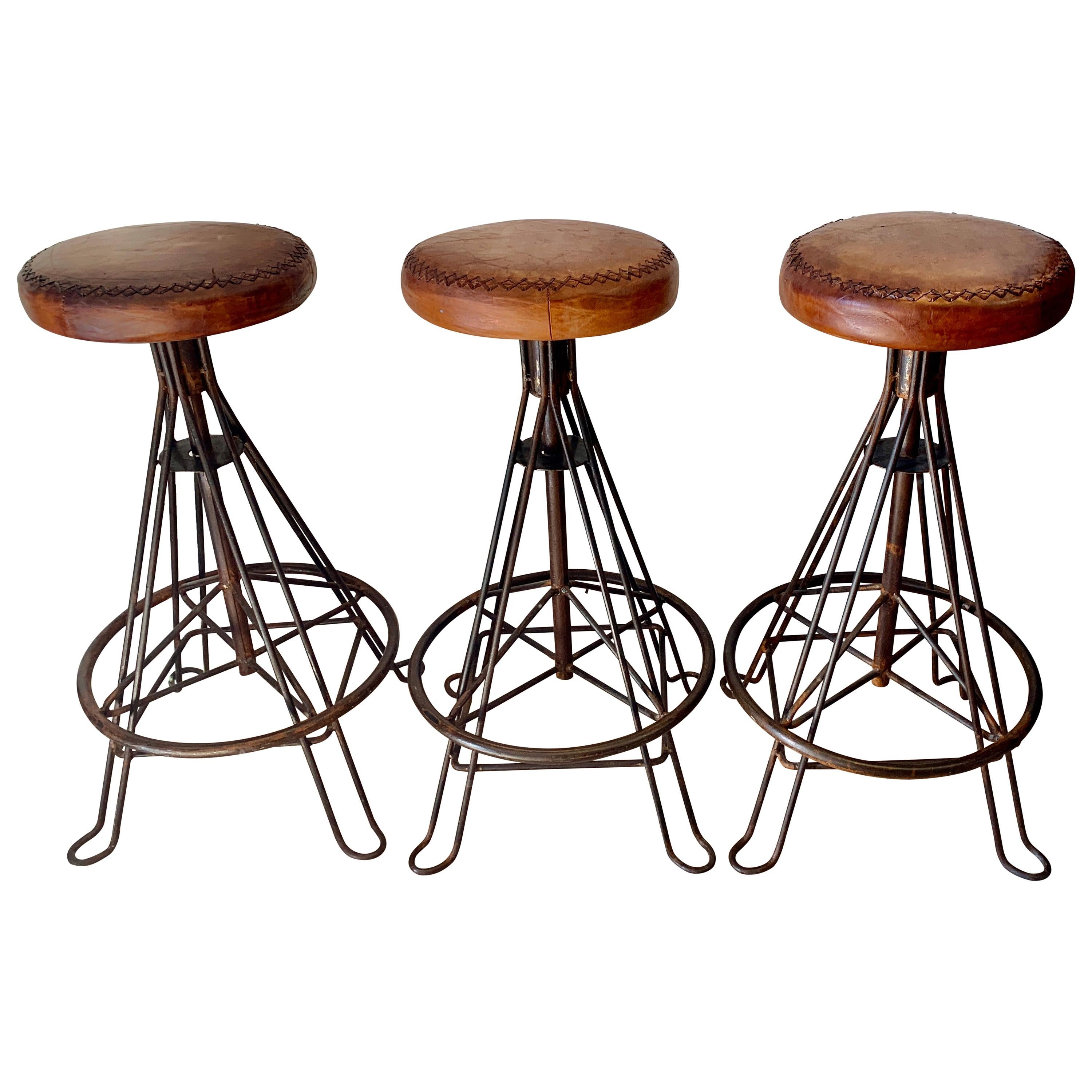 Set of Three Wrought Iron and Stitched Leather Bar Stools