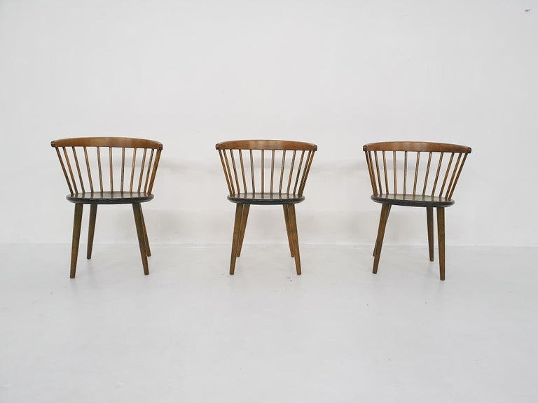 3 dark oak spindle back chairs by Yngve Ekstrom for Nesto.