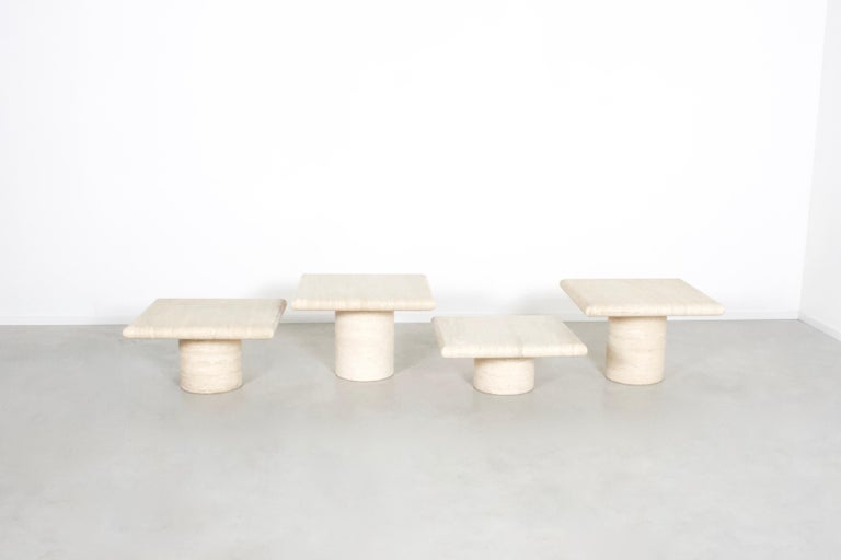 Set of four travertine tables in very good condition.  Manufactured by Up&Up in the 1970s in Italy.  The tables have a thick solid travertine top with rounded edges.  The bases of the tables are round and also made of travertine.  They have