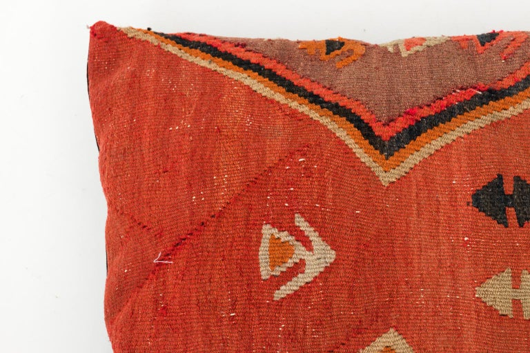 Set of four Turkish Kilim fabric pillows with Geometric detail, circa 20th century. Please note that the fabric has minor fading and repairs due to wear consistent with age.