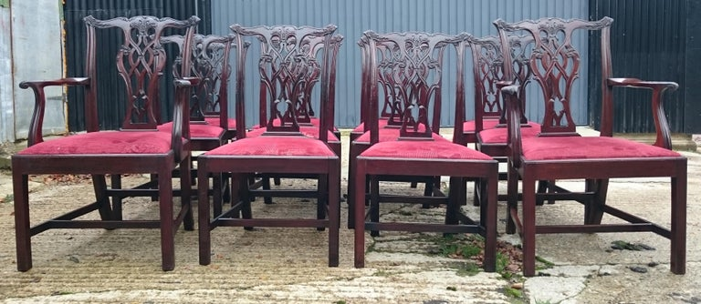 Fine quality set of twelve antique dining chairs made by Edwards and Roberts of London. These chairs are a grand scale which makes them better able to accomodate the modern diner than a period chair. They are strong, with H frame stretchers for