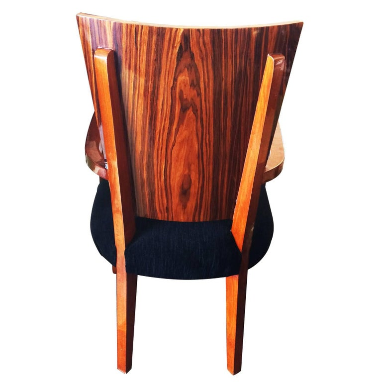 Art Deco set of 10 dining plus two carver chairs, in Macassar wood and black textured velvet seats. All in excellent condition, having been totally re-upholstered and re-covered, in a lustre glaze, like having a coating of approximate 1/2mm of