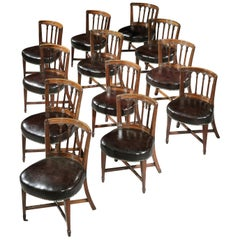 Set of Twelve English George III Brown Mahogany Library Chairs