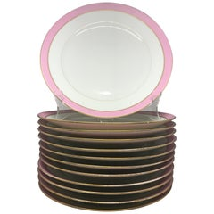 Set of Twelve French Pink and Gilt Banded Plates