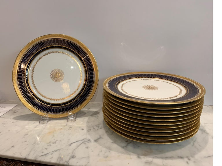 Set of twelve gold gilt and cobalt service plates BWM & Co For Gillman, NYC,