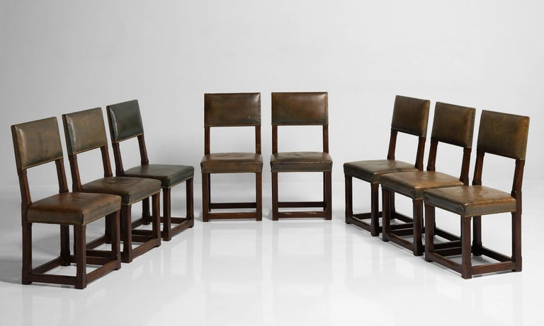 Set of twelve gothic oak dining chairs, England, circa 1880.