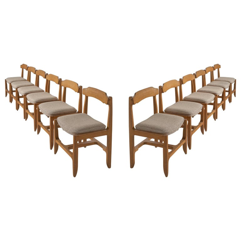 Set of Twelve Guillerme et Chambron Dining Chairs in Solid Oak For Sale
