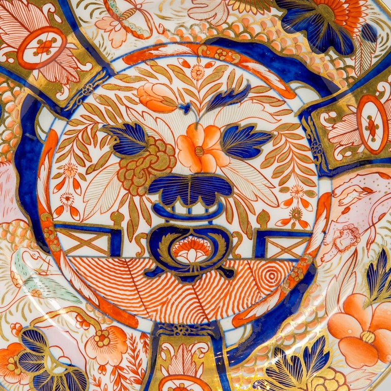 Why we love it: The intensity of the Imari colors and the wonderful pink spotted lion. This set of twelve Imari Admiral Nelson pattern plates was made by Coalport circa 1810. The plates were hand-painted in England. They are decorated in a